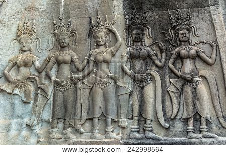 Detail Of A Stone Carved Relief In The Famous Angkor Wat In Cambodia And The Largest Religious Monum