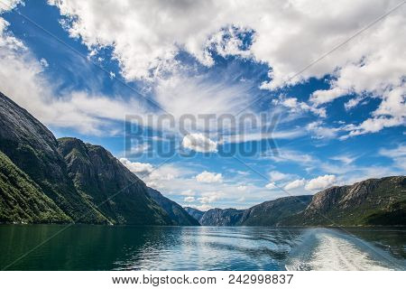 Amazing Nature View With Beautiful Clouds Above The Fjord. Location: Lysefjorden, Norway, Europe. Ar