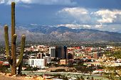 The Skyline of Tucson Arizona with the cloud covered mountains poster