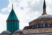 Travel to Turkey - green dome and roof of Mausoleum of Jalal ad-Din Muhammad Rumi (Mevlana) and Dervish Lodge (Tekke) of the muslim Mevlevi order in Konya city poster