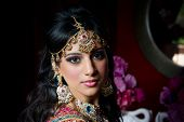 Image of a gorgeous Indian bride traditionally dressed poster