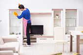 Contractor man cleaning house doing chores poster