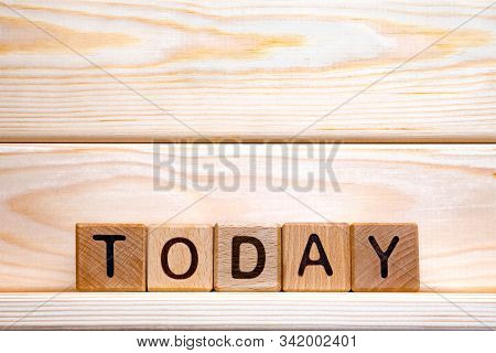 Today Word Concept. The Word Today On Wooden Cubes. We Often Delay Taking Action Or Steps To Progres
