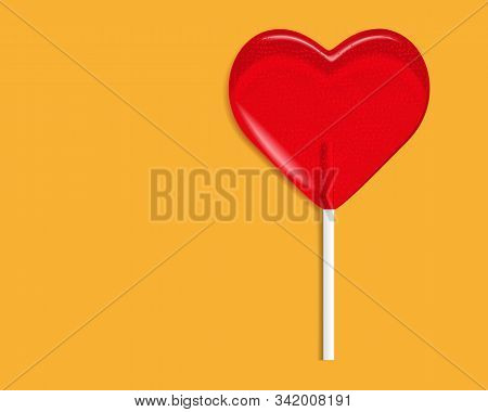 Heart Lollipop Candy Isolated On A Orange Background