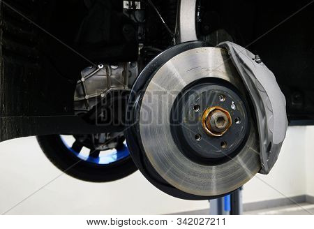Brake Disc And Caliper Of A Modern Car. Concept Service And Repair Of A Modern Luxury Car Using Orig