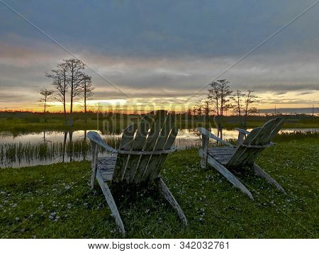 Louisiana Sunset Swamp And Chairs