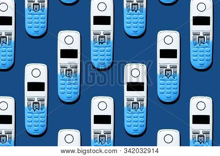 Pattern Image Of Dect Phones Turning Into A Toy Phones On Classic Blue Background. The Concept Of Te