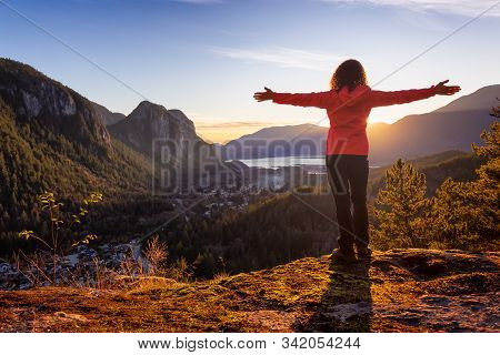 Adventurous Girl Hiking In The Mountains During A Sunny Autumn Sunset. Taken Squamish, North Of Vanc