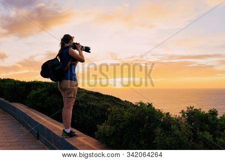 Sunrise Or Sunset And Young Girl On Capo Ferro In Costa Smeralda