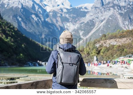 Young Man Traveler Traveling At Blue Moon Valley, Landmark And Popular Spot Inside The Jade Dragon S