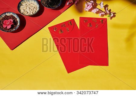 Flatlay Of Tet Celebration Table With Lucky Money Envelopes And Bowls Of Various Seeds