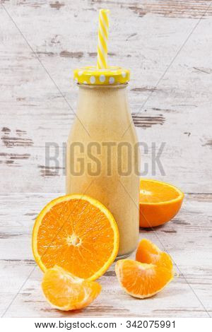 Fresh Healthy Smoothie From Citrus Fruits Containing Natural Vitamins And Minerals. Dieting And Slim