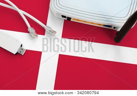Denmark Flag Depicted On Table With Internet Rj45 Cable, Wireless Usb Wifi Adapter And Router. Inter