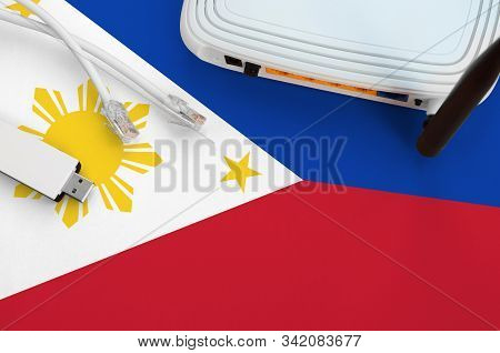 Philippines Flag Depicted On Table With Internet Rj45 Cable, Wireless Usb Wifi Adapter And Router. I