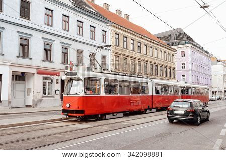 Typical Red Tram On Road In Mariahilfer Strasse In Vienna