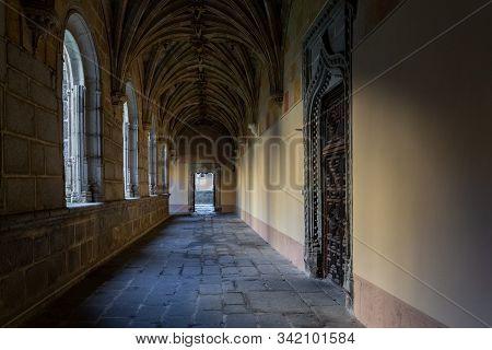 Avila, Spain - January 23, 2014: Cloister In The Monastery Of Santo Tomas. Cloister Of Silence.