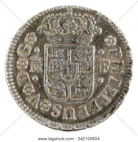 Ancient Spanish Silver Coin Of The King Felipe V. 1738. Coined In Madrid. Medio Real. Obverse.