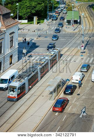 Typical Red Tram And Car Transport On Museumstrasse In Vienna