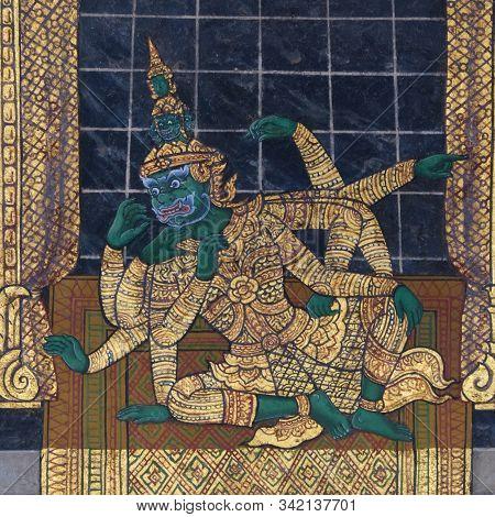 Bangkok, Thailand, December 27, 2018. An Ancient Wall Drawing Depicting A Mythical Ten-armed Creatur