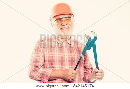 Man Bearded Plumber Wear Helmet And Hold Wrench Tool. Repair Concept. Sanitary Engineering. Experien
