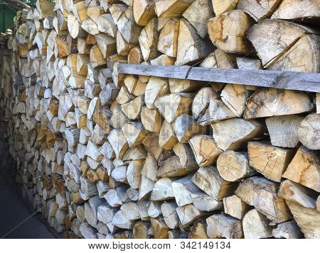 Stacked Firewood (woodpile) For The Stove In The Open Air Close-up