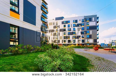 New Residential Apartment Flat House Building With Child Playground Reflex