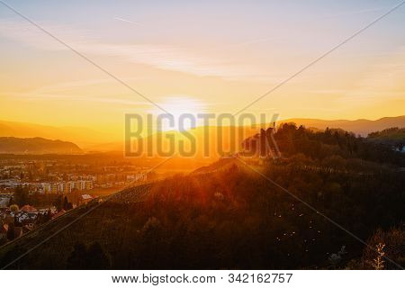Romantic Sunset Landscape And Cityscape With Vineyards In Maribor