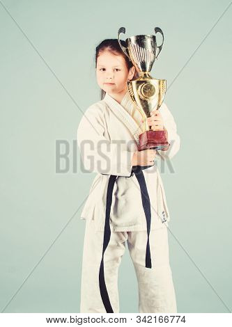 Knockout. Energy Activity For Kids. Small Girl With Champion Cup. Martial Arts. Practice Kung Fu. Ha