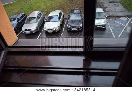 Chomutov, Czech Republic - December 25, 2019: Cars In Front Of House During Christmas