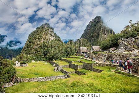 Machu Picchu Pueblo,  Peru - Jan 8, 2019:   Panoramic view on Ancient city of Machu Picchu in Peru. South America.