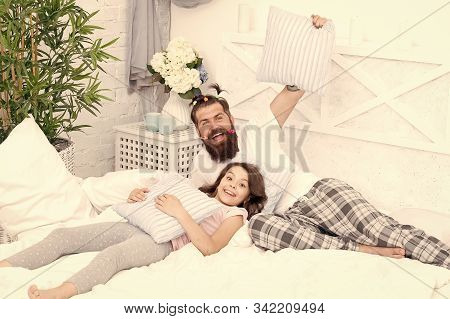 Happy Fatherhood. Man Bearded Hipster With Childish Hairstyle Colorful Ponytails And Daughter In Paj