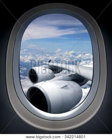 Airplane Turbine Engine From Window View Angle With Cloudy Blue Sky