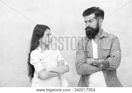Family Conflict. Bearded Hipster Man And Child Girl. Confrontation Concept. Frowning Man And Serious