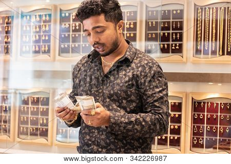 Concept Of Small Business Owners - Young Owner Or Entrepreneur At Jewelry Showroom Counting Money, S