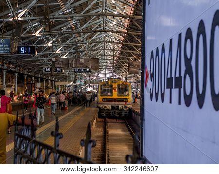 Commuters Walking Inside Chhatrapati Shivaji Terminus Railway Station, A Historic Railway Station An