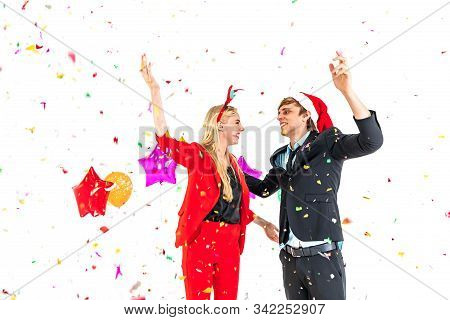Young Couple Enjoy Dance With Colorful Confetti In New Year Celebration Hangout Party And Isolated O