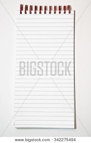 Directly Above View Of Spiral Lined Notebooks On White Background - Stock Photo
