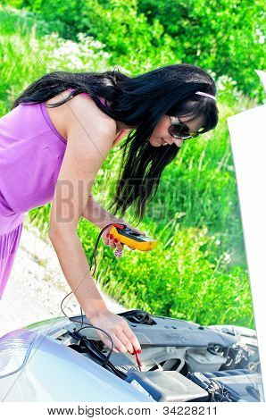 Woman Controsl Lead acid Battery Charge With Voltmeter