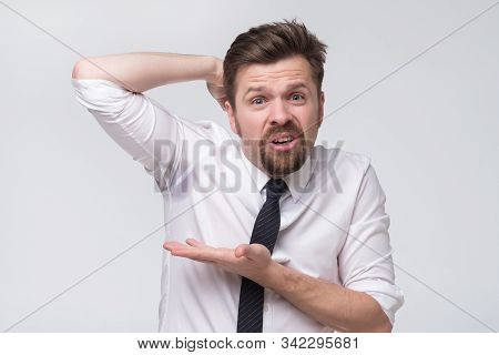 Mature Caucasian Male Manager Notices Sweat Under Armpit Before Important Meeting.