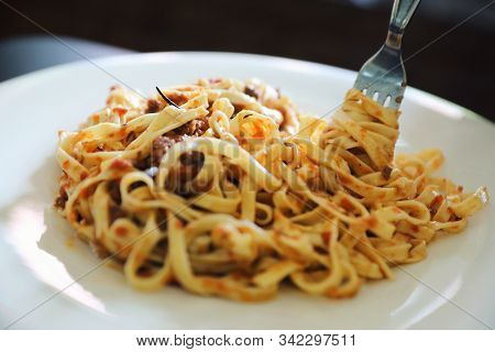 Spaghetti Bolognese With Minced Beef And Tomato Sauce Garnished With Parmesan Cheese And Basil , Ita