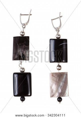 Top View Of Hand Crafted Silver Earrings From Polished Agate And Nacre Beads Isolated On White Backg