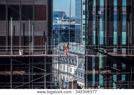 Construction Worker On A High Scaffold On A Building Site In Central London, Uk