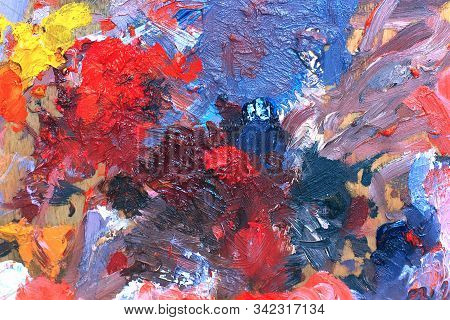 Artist Palette With Mixed Oil Paints. Abstract Background With Colorful Brush Strokes On A Canvas. M