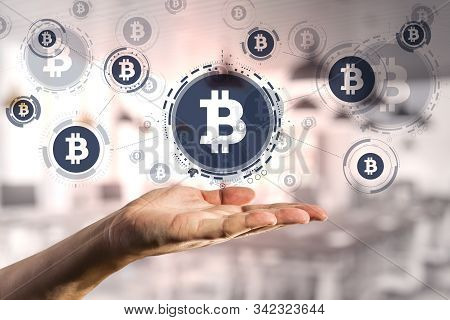 Hand Holding Glowing Blue Bitcoin Interface. Cryptography And Cryptocurrency Concept.