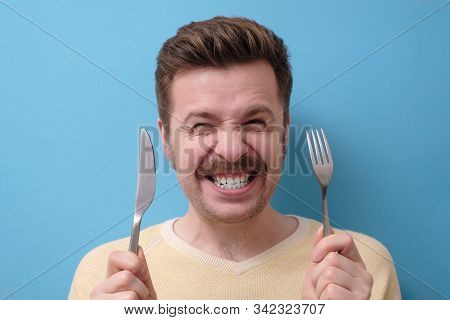 Crazy, Starving Man With Mustache Holds A Knife With A Fork In His Hands, Grins. I Am Starving Conce