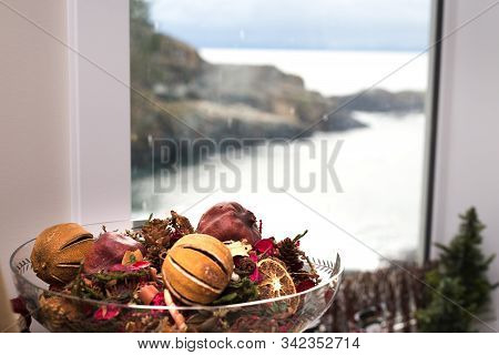Chirstmas Potpourri In A Dish Beside A Window With An Ocean View.