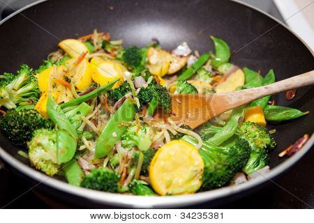 Healthy vegetable stir fry cooked in a Chinese style wok.