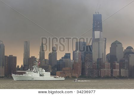 HOBOKEN, NJ - MAY 23: The warship HMCS Iroquois (Canada) sails on the Hudson River past Manhattan during the Parade of Sail on May 23, 2012 in Hoboken, NJ. The parade is the start of Fleet Week.