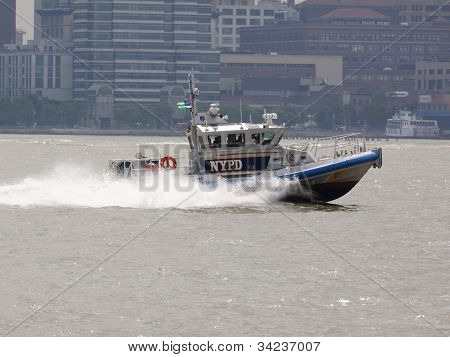 HOBOKEN, NJ - MAY 23: A NYPD boat patrols the Hudson River between Manhattan New Jersey during the Parade of Sails on May 23, 2012 in Hoboken, NJ. The parade marks the start of Fleet Week.