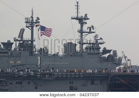 HOBOKEN, NJ - MAY 23: The crew and deck of the USS Wasp (LHD 1) on the Hudson River near Manhattan during the Parade of Sails on May 23, 2012 in Hoboken, NJ. The parade marks the start of Fleet Week.
